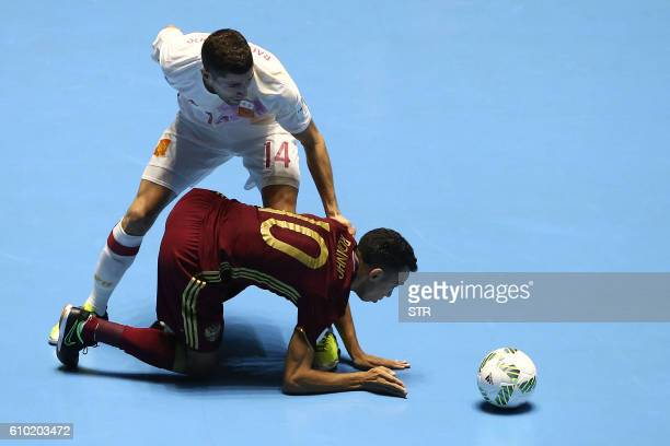 TOPSHOT Russia's Robinho vies for the ball with Raul Campos of Spain during their Colombia 2016 FIFA Futsal World Cup match at the Coliseo El Pueblo...