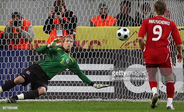Russia's Roman Pavlyuchenko scores a penalty shot to Wales's Wayne Hennessey on September 10 2008 during their World Cup 2010 qualifying football...