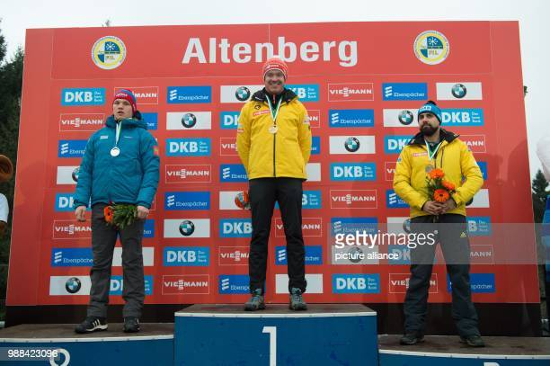 Russia's Roman Repilow , Germany's Felix Loch and Germany's Andi Langenhan stand on the podium during the award ceremony after the the men's single...