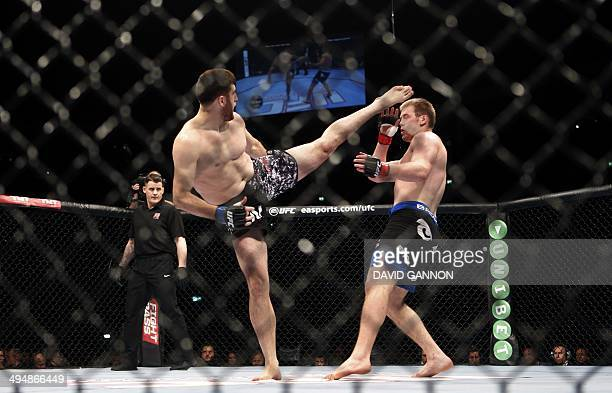 Russia's Ruslan Magomedov and Czech Republic's Viktor Pesta fight in the ring during the Ultimate Fighting Championship Fight Night at the O2 World...
