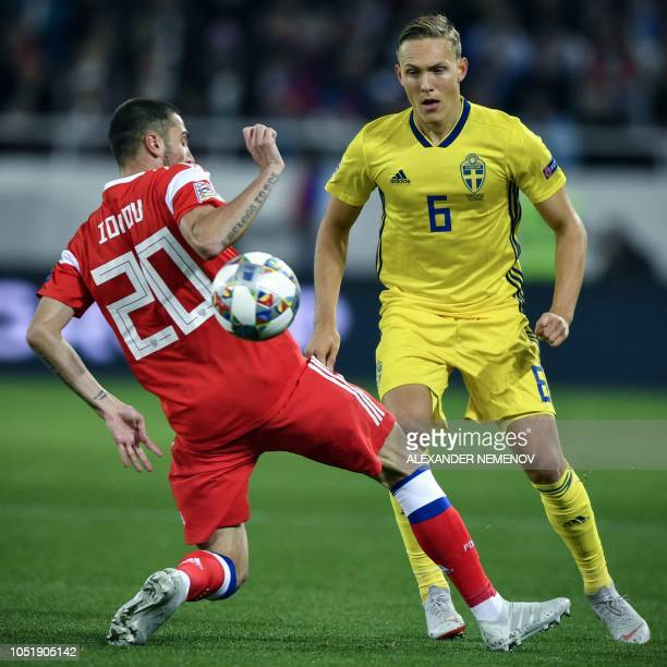 Russia's Russian midfielder Aleksei Ionov vies with Sweden's Swedish defender Ludwig Augustinsson during the UEFA Nations League football match...