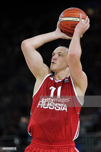 Russia's Semen Antonov throws the ball during the group A qualification basketball match between Israel and Russia at the EuroBasket 2015 in...