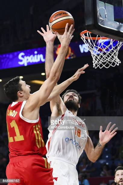 Russia's Semen Antonov vies with Spain's Pierre Oriola during the FIBA Euro basket 2017 men's 3rd game match between Spain and Russia at Fenerbahce...