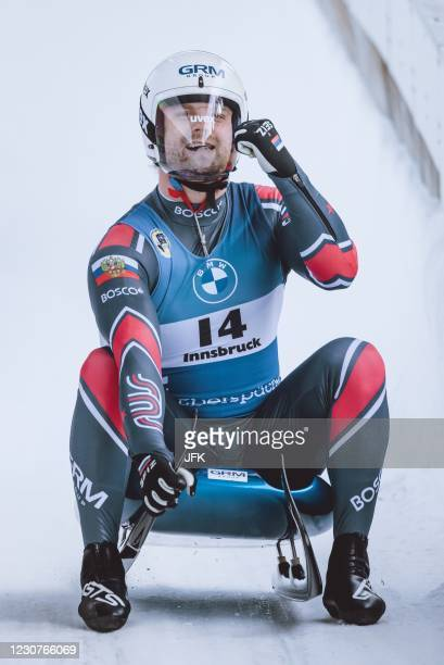 Russia's Semen Pavlichenko celebrates placing third during the men's sprint singles competition of of the Luge World Cup at the Olympia Eiskanal in...