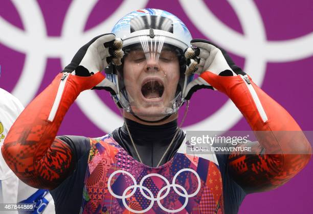 Russia's Semen Pavlichenko competes during the Men's Luge Singles run two at the Sliding Center Sanki during the Sochi Winter Olympics on February 8...