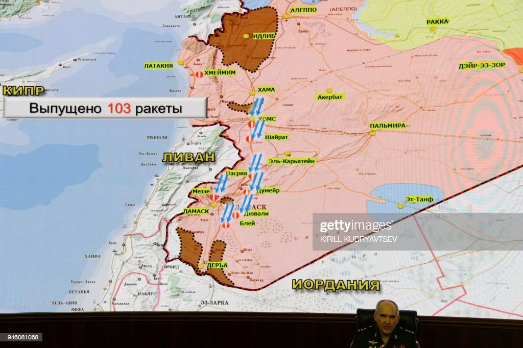 Russia's senior military officer Sergei Rudskoi sits bellow a map of Syria screened during a briefing at the Russian Defence Ministry headquarters in Moscow on April 14, 2018, following overnight joint strikes by the US, Britain and France in Syria. The Russian military said on April 14, 2018 that Western allies fired 103 cruise missiles including Tomahawk missiles at Syria but that Syrian air defence systems managed to intercept 71 of them. The US, Britain and France conducted joint strikes overnight on April 14 against the Syrian regime of Bashar al-Assad in response to alleged chemical weapons attacks. / AFP PHOTO / Kirill KUDRYAVTSEV