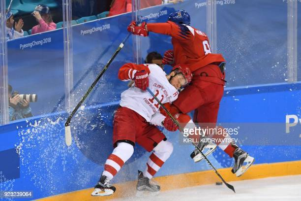 TOPSHOT Russia's Sergei Andronov and Czech Republic's Jakub Nakladal collide in the men's semifinal ice hockey match between the Czech Republic and...