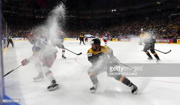 Russia´s Sergei Andronov and Germany´s Yannic Seidenberg vie during the IIHF Ice Hockey World Championships first round match between Germany and...