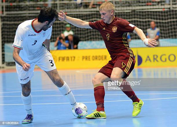 Russia's Sergey Abramov vies for the ball with Iran's Ahmad Esmaeilpour during their Colombia 2016 FIFA Futsal World Cup semifinal match in Medellin...