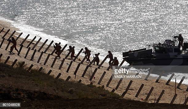 Russia's servicemen take part in a military exercise called Kavkaz 2016 at the coast of the Black Sea in Crimea on September 9 2016 / AFP / VASILY...