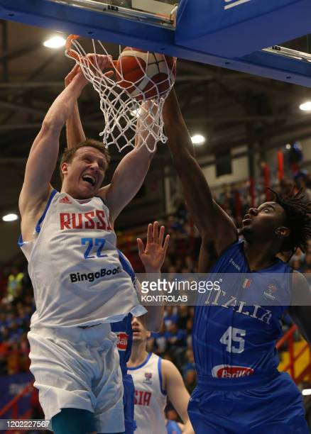 Russia's shooting guard Dmitrii Kulagin scores as fighting with Italy's small forward Nikola Akele during the FIBA Eurobasket 2021 Group B qualifiers...