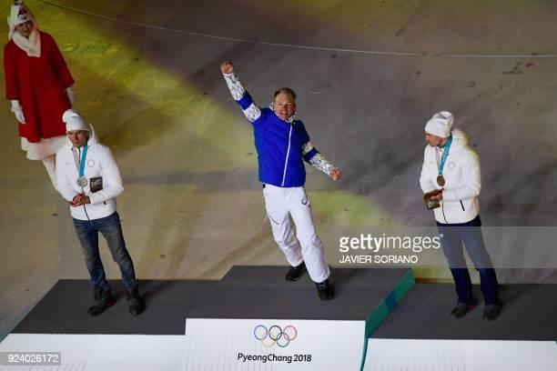 Russia's silver medallist Alexander Bolshunov Finland's gold medallist Iivo Niskanen and Russia's bronze medallist Andrey Larkov celebrate on the...