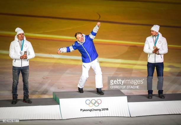 TOPSHOT Russia's silver medallist Alexander Bolshunov Finland's gold medallist Iivo Niskanen and Russia's bronze medallist Andrey Larkov celebrate on...