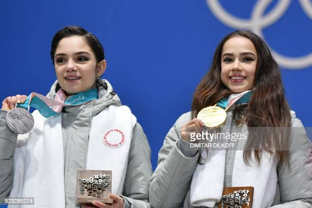 TOPSHOT Russia's silver medallist Evgenia Medvedeva and Russia's gold medallist Alina Zagitova pose on the podium during the medal ceremony for the...