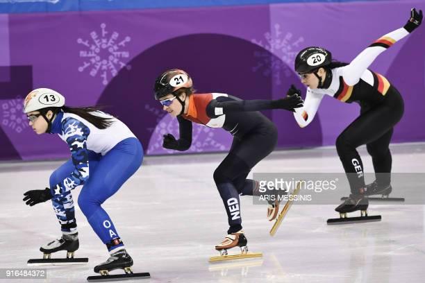 Russia's Sofia Prosvirnova , Netherlands' Yara van Kerkhof and Germany's Bianca Walter take part in the women's 500m short track speed skating heat...