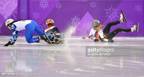 Russia's Sofia Prosvirnova, Netherlands' Yara van Kerkhof and Germany's Anna Seidel crash in the women's 1,000m short track speed skating heat event...