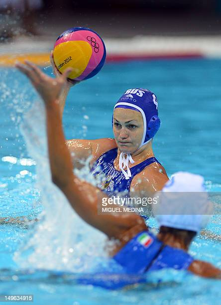 Russia's Sofya Konukh is challenged by Italia's Simona Abbate during the women's water polo preliminary round groupe B match between Italy and Russia...