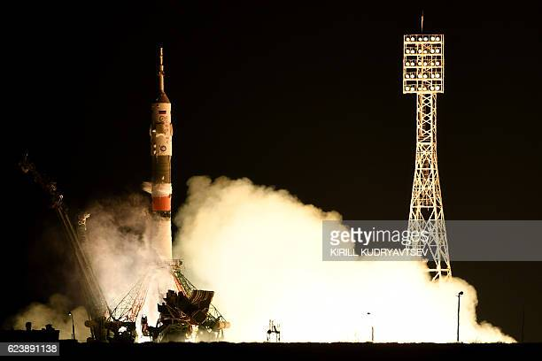TOPSHOT Russia's Soyuz MS03 spacecraft carrying the International Space Station crew France's astronaut Thomas Pesquet Russia's cosmonaut Oleg...