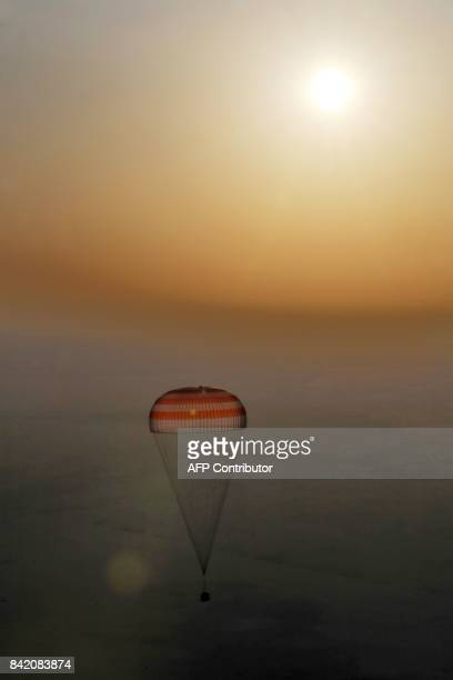 Russia's Soyuz MS04 space capsule carrying the International Space Station crew of Russian cosmonaut Fyodor Yurchikhin and US astronauts Peggy...