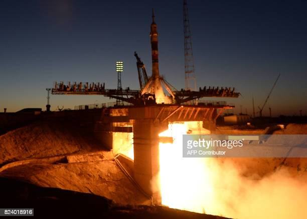 Russia's Soyuz MS05 rocket carrying a threeman crew from Italy Russia and the United States blasts off on July 28 2017 from the Baikonur cosmodrome...