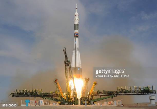 TOPSHOT Russia's Soyuz MS09 spacecraft carrying the members of the International Space Station expedition 56/57 NASA astronaut Serena AunonChancellor...