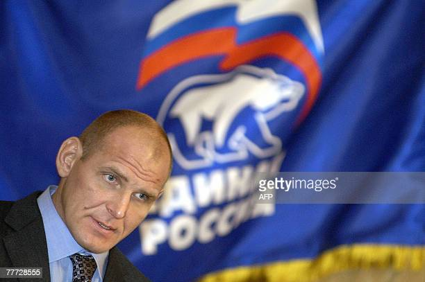 Russia's State Duma deputy and former world wrestling champion Alexander Karelin speaks during a preelection campaign of the proKremlin United Russia...