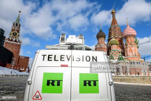 A Russia's statecontrolled Russia Today television broadcast van is seen parked in front of St Basil's Cathedral and the Kremlin next to Red Square...
