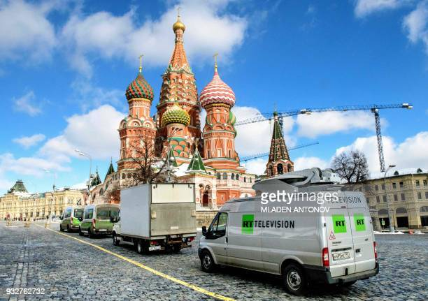 Russia's statecontrolled Russia Today television broadcast vans are seen parked in front of St Basil's Cathedral and the Kremlin next to Red Square...