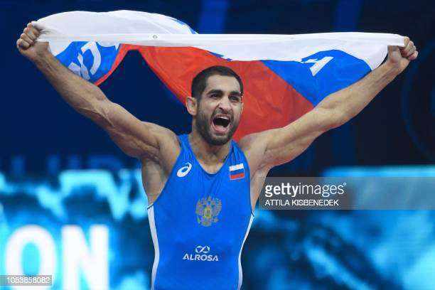 Russia's Stepan Maryanyan celebrates his victory Uzbegistan's Elmurat Tasmuradov after the final of the men's GrecoRoman style 63kg category at the...