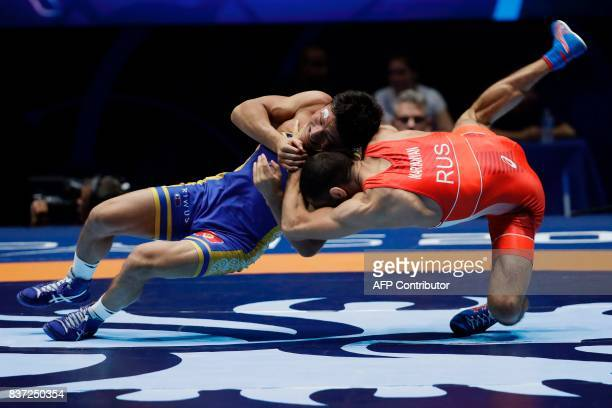 TOPSHOT Russia's Stepan Maryanyan competes for the bronze medal against Kirghizstan's Kanybek Zholchubekov during the men's GrecoRoman Seniors 59kg...
