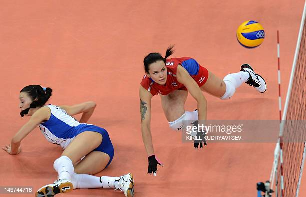 Russia's Svetlana Kryuchkova attempts to set during the women's preliminary pool A volleyball match between Japan and Russia in the 2012 London...