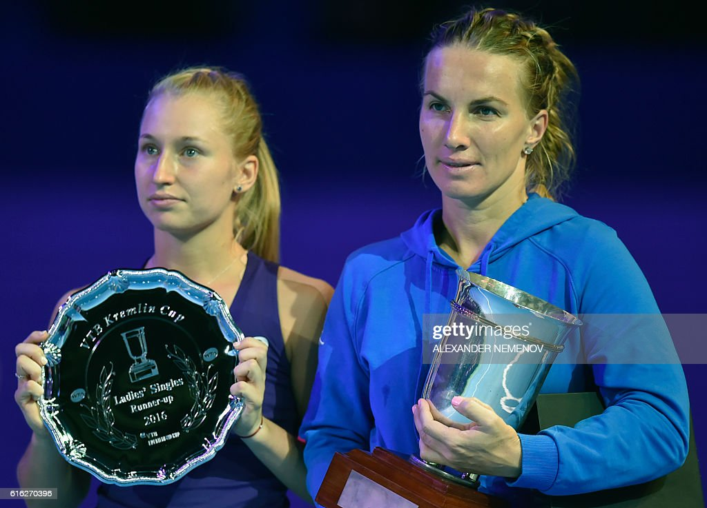 Russia's Svetlana Kuznetsova (R) celebrates with her trophy after defeating Australia's Daria Gavrilova (L) after the Kremlin Cup tennis tournament final match in Moscow on October 22, 2016. / AFP / ALEXANDER