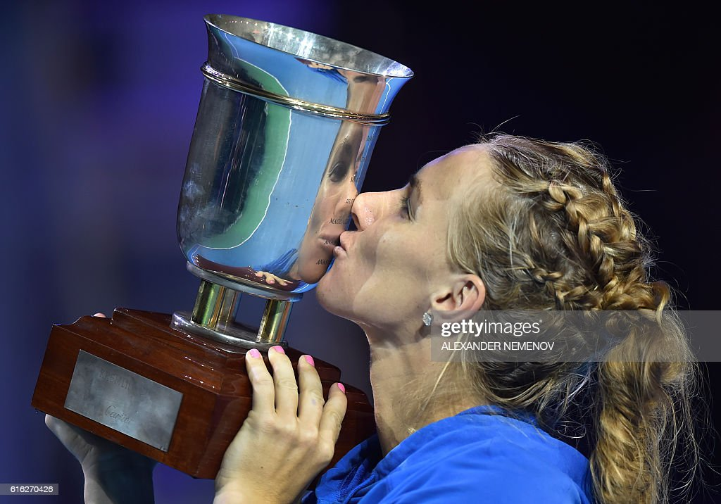 Russia's Svetlana Kuznetsova celebrates with her trophy after defeating Australia's Daria Gavrilova during the Kremlin Cup tennis tournament final match in Moscow on October 22, 2016. / AFP / ALEXANDER