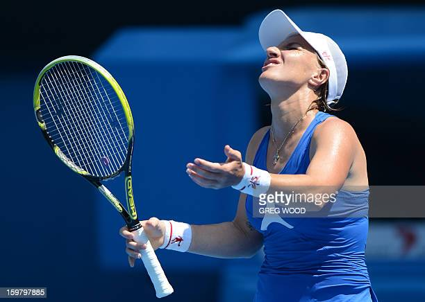 Russia's Svetlana Kuznetsova reacts after a point against Denmark's Caroline Wozniacki during their women's singles match on day eight of the...
