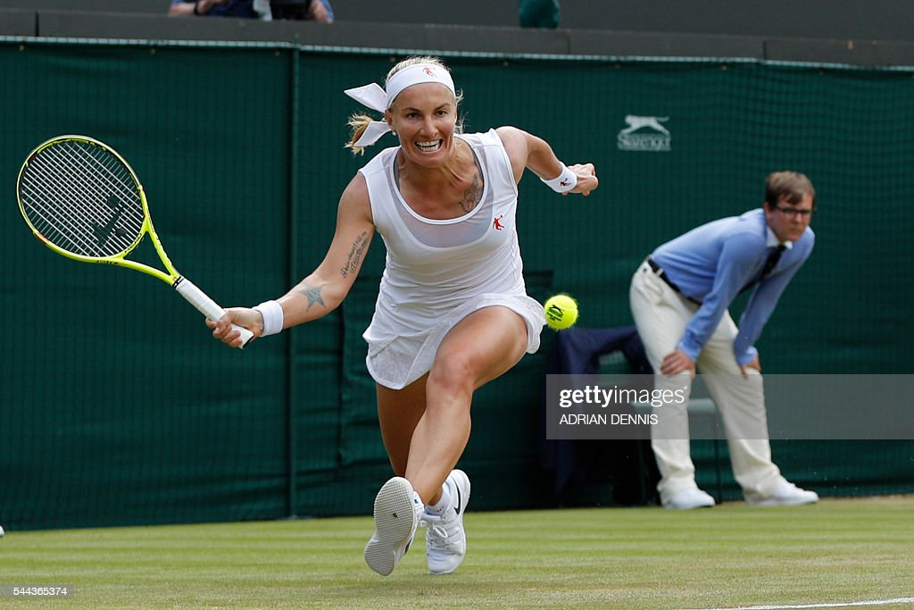 TOPSHOT - Russia's Svetlana Kuznetsova returns to US player Sloane Stephens during their women's singles third round match on the seventh day of the 2016 Wimbledon Championships at The All England Lawn Tennis Club in Wimbledon, southwest London, on July 3, 2016. / AFP / ADRIAN