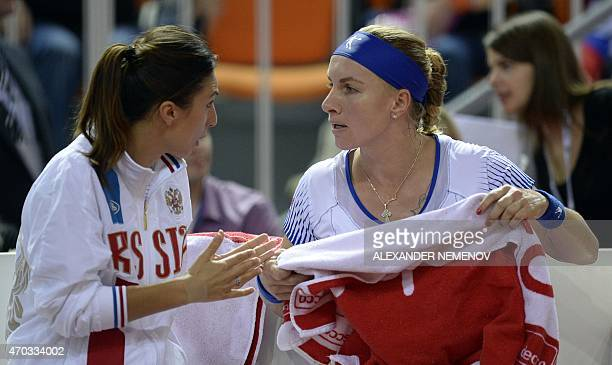 Russia's Svetlana Kuznetsova talks to Russia's team captain Anastasia Myskina playing against Germany's Andrea Petkovic during their Federation Cup...