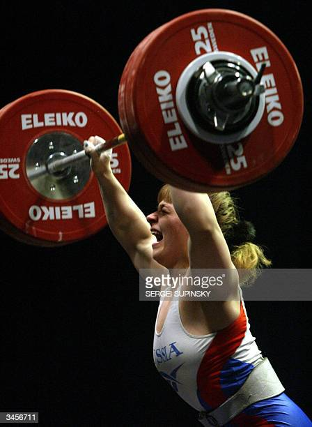 Russia's Svetlana Podobedova celebrates as she lifts 1375 kilograms in the clean and jerk event in the women's 75 kg class at the 83rd Men's and 17th...