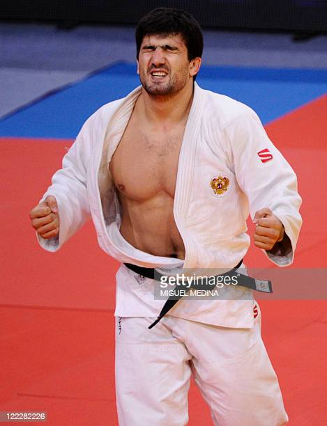 Russia's Tagir Khaybulaev celebrates his victory over Kazakhstan's Maxim Rakov during their final match in the 100kg category at the Judo World...
