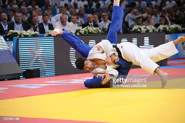 Russia's Tagir Khaybulaev fights against Kazakhstan's Maxim Rakov during their final match in the 100kg category at the Judo World Championships on...