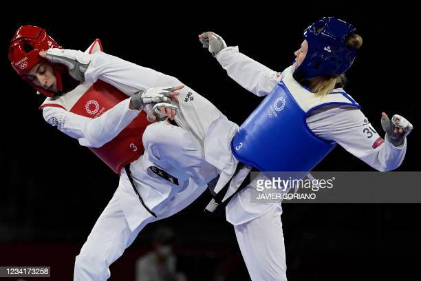 Russia's Tatiana Minina and Refugee Olympic Team's Kimia Alizadeh Zenoorin compete in the taekwondo women's -57kg semi-final bout during the Tokyo...