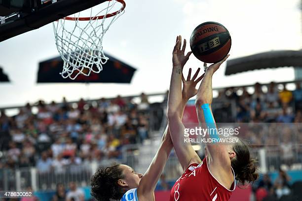 Russia's Tatiana Vidmer vies with Ukraine's Krystyna Matsko during the Women's 3x3 basketball final at the 2015 European Games in Baku on June 26...