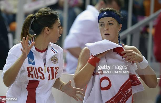 Russia's team captain Anastasia Myskina talks to Russia's Anastasia Pavlyuchenkova playing against German Angelique Kerber during their Federation...