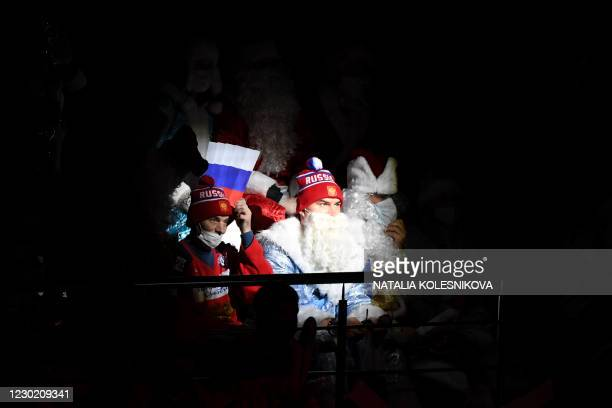 Russia's team fans dressed as Ded Moroz watch the Channel One Cup of the Euro Hockey Tour ice hockey match between Russia and Czech Republic at CSKA...