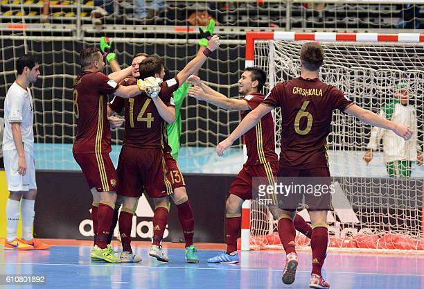 TOPSHOT Russia's team players celebrate their victory over Iran during their Colombia 2016 FIFA Futsal World Cup semifinal match in Medellin Colombia...