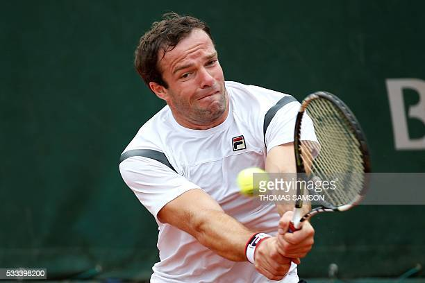 Russia's Teimuraz Gabashvili returns the ball to US player Donald Young during their men's first round match at the Roland Garros 2016 French Tennis...