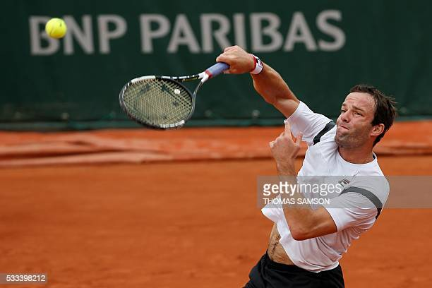 Russia's Teimuraz Gabashvili serves the ball to US player Donald Young during their men's first round match at the Roland Garros 2016 French Tennis...