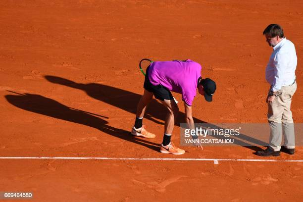 Russia's tennis player Andrey Kuznetsov contests a point to Czech Tomas Berdych during the Monte-Carlo ATP Masters Series tournament on April 17,...
