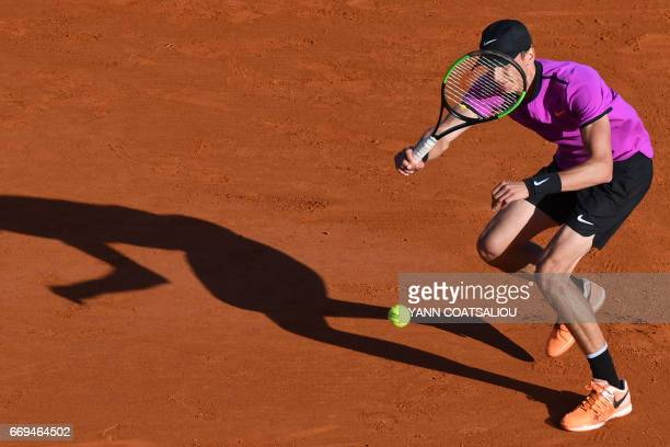 Russia's tennis player Andrey Kuznetsov hits a return to Czech Tomas Berdych during the Monte-Carlo ATP Masters Series tournament on April 17, 2017...