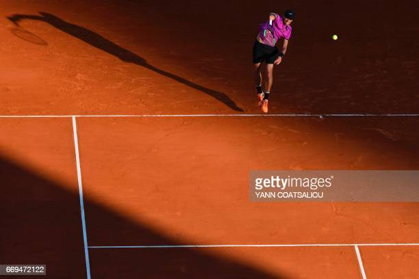 Russia's tennis player Andrey Kuznetsov serves to Czech Tomas Berdych during the Monte-Carlo ATP Masters Series tournament on April 17, 2017 in...