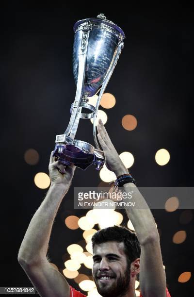 Russia's tennis player Karen Khachanov poses with the trophy as he celebrates his victory over France's tennis player Adrian Mannarino during the...